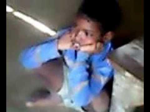 A indian boy watching tv