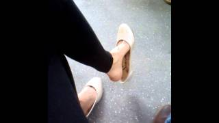 Shoe dangling on the subway