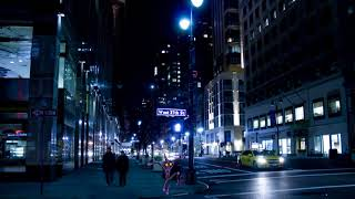 walking through the city at night but some place is playing the Vrains theme really loudly