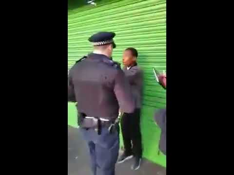 Gang of UK Police officers stop and search young black boy for riding bike