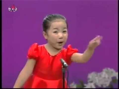 asian cute little girl singing .