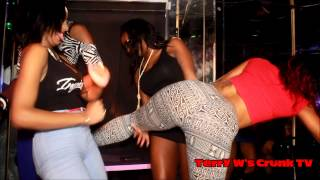 Booty popping and ass spanking on stage in night club.