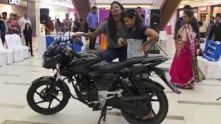Kick starting a bike - Women's Day Special