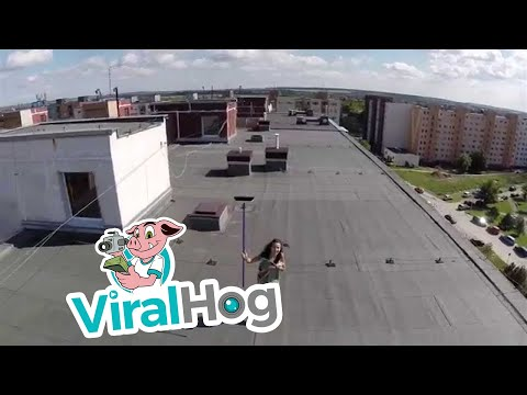 Drone helicopter spies topless woman ViralHog