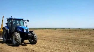 New holland ts 135a and koutsikos laser levelling of rice at halastra thessaloniki