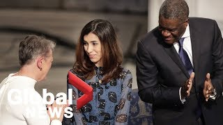 Nobel Peace Prize winners receive their awards