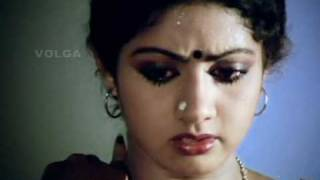 Sridevi removing her blouse and showing her bra.