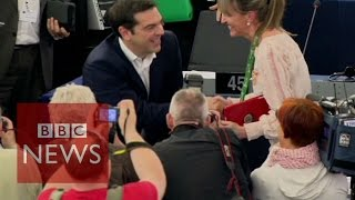 Boos & cheers for Greek Prime Minister Alexis Tsipras - BBC News