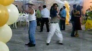drunk men dancing at mexican party