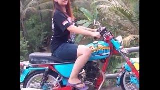 Girl Starting Bike to Kick Start