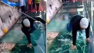 Cracking prank: Tour guide freaks out on a glass walk after it 'cracks'