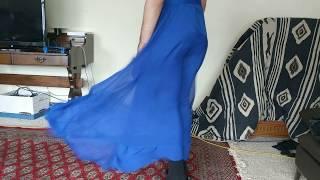 Long Blue Dress Blown by Strong Blower