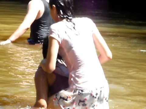 Taking a bath in the river in El Salvador