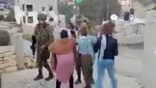Palestinian women caught hitting, pushing and cursing Israeli soldiers in order to provoke them.