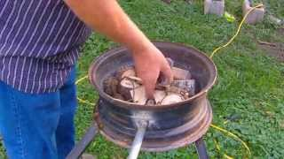 Home made car wheel forge first time trying with wood fuel