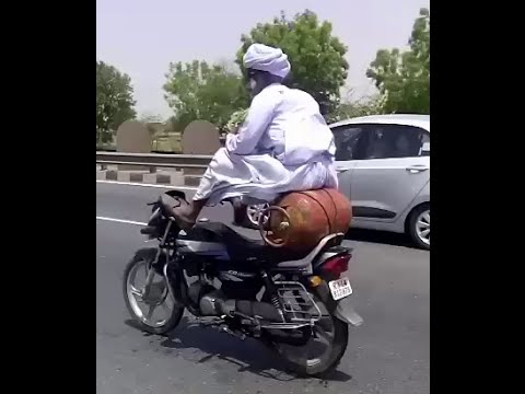 Bike Stunt on Indian road by a desi old man