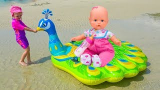 Настя и кукла Беби Бон играют на море и детской площадке Nastya and baby born doll pretend play