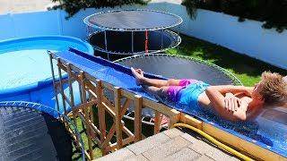 GIANT Backyard Water Slide in our Trampoline Water Park!!