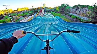 SNEAKING INTO WATERPARK TO RIDE BMX!