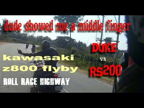 Rs200 vs KTM duke200 Roll race || curve search || Indian motovlogs