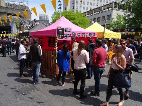 Walking amongst the Indian and Pakistan Street Food stalls at Alchemy Festival, Southbank, London.