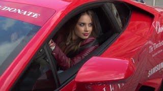 Xenia Tchoumitcheva driving a Lamborghini Huracan