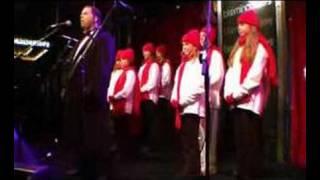 Paul sings O Holy Night at Bloomingdales, 19/11