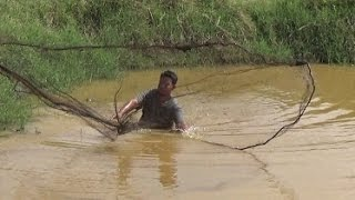Living off the land, Cast net fishing in the dry season.