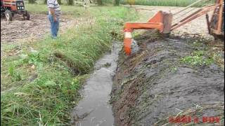 Drainage ditch  cleaning ; with a special ....