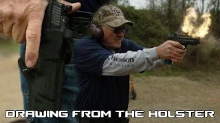 How to quickly draw out of a tactical holster with world record shooter, Jerry Miculek (60FPS)