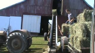 Putting Hay In A Barn Loft With A Kewanee Elevator.