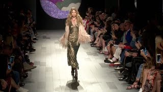 Gigi Hadid loses her shoe while on the runway for the Anna Sui Fashion Show
