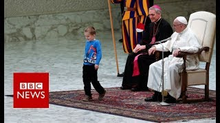 Small boy upstages the Pope during audience  - BBC News