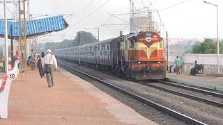 Bhubaneswar Bangiriposi Intercity comes out of bushes and chugs through Patia with VSKP WDM3D