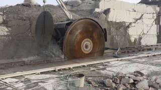 Giant disc saw cutting blocks in a granite quarry.