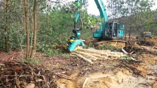 kerja Harvester alat pengupas+pemotong kayu