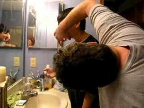 Father teaches son to shave
