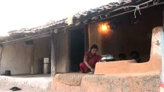 Madai village woman cooking food in an outdoor kitchen