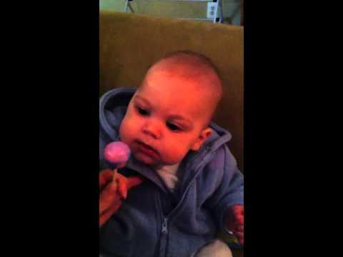 Baby Carter licking a lollipop