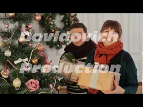 Xxx Mp4 A Beautiful Young Couple In Love Near The New Year Tree Giving Presents To The Viewer Christmas And 3gp Sex