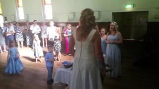 Baby boy catches wedding garter.