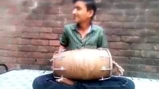 Small boy play dholak.