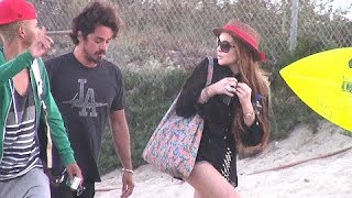 Lindsay Lohan Gets Close To Mystery Man While Hitting The Beach With Dina And Cody Lohan [2012]
