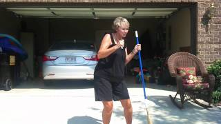 Funny lady dancing with broom