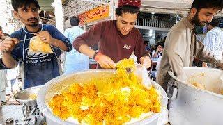Street Food in Karachi - GOLDEN Chicken Biryani + HALEEM - Pakistani Street Food Tour of Karachi!