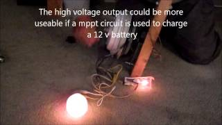 Using a converted ceiling fan motor as a hand cranked battery charger.wmv