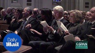 Obama appears to joke with Melania at Barbara Bush