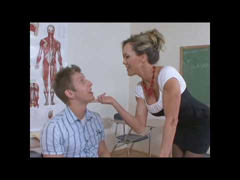 Beautiful Teacher in education classroom a cute student How to french kissing. Student teacher test.