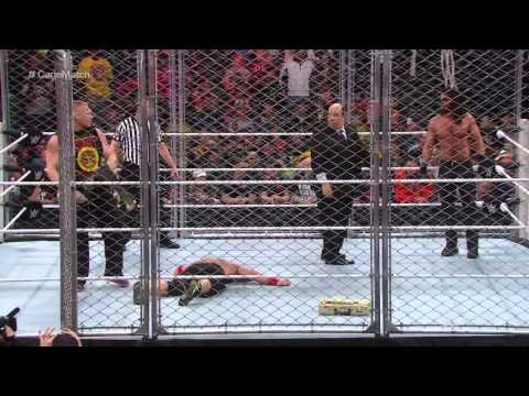brock lesnar interrupts steel cage match between john cena and seth rollins 12/15/14