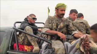 مناوشات الرقة بين تنظيم الدولة والأكراد المدعومين أميركيا